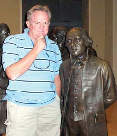 Courtesy photo<br/>Kelly Cordes stands next to a statue of James Madison in the Hall of Statues, which is in the National Constitution Center in Philadelphia. The center opened on July 4, 2003. Its website is www.constitutioncenter.org.