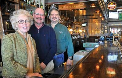 Matt Hinshaw/The Daily Courier <br>Tonya Mock, director of advertising, Rich Bates, director of operations, and Michael Joyal, general manager of Murphy's Restaurant, stand behind the bar in Prescott Tuesday afternoon.