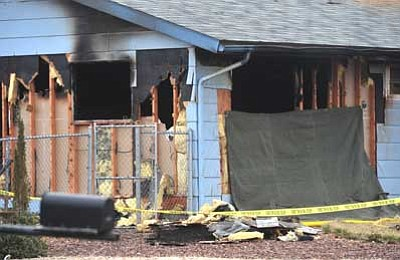 Les Stukenberg/The Daily Courier<br>Two people and a cat died in this house fire that occurred Wednesday morning in the 4200 block of Kearny Drive in Prescott Valley.