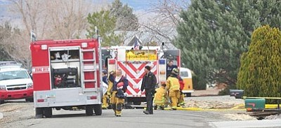 Les Stukenberg/The Daily Courier<br/>Central Yavapai firefighters break down their equipment after putting out a house fire in which two people and a cat died in the 4200 block of Kearney Drive in Prescott Valley Wednesday morning.