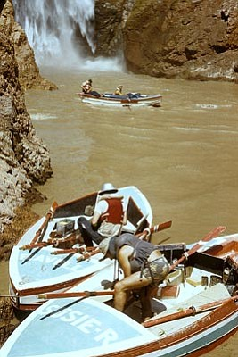 "Courtesy/Joe Szep collection<br/>""Flavell,"" ""Susie R"" and ""Gem"" (in river) at Deer Creek Falls on the Colorado River during the Gem disappeared.<br/>"