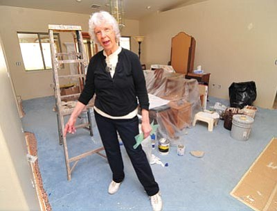 Les Stukenberg/The Daily Courier<br/>Judy Winter talks about improvements, which include new flooring and a fresh coat of paint, she is having done at her Prescott home.
