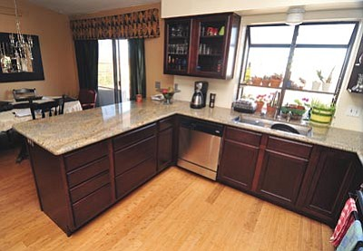 Les Stukenberg/The Daily Courier<br/>A recently remodled kitchen, after new cabinets, new floor, new countertop, new sink and new appliances transformed this Prescott Valley home. Below is the kitchen – before.