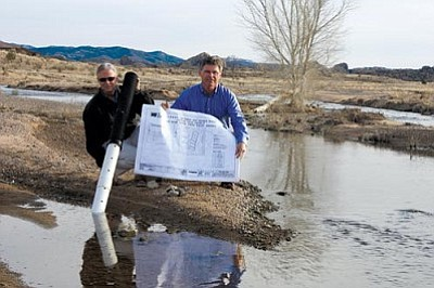 Raymond Buettner/Courtesy<br/>Civiltec President Rick Shroads and Project Engineer Doug McMillan check out the Granite Creek area with design plans and pipe materials for the Upper Verde Coalition's pilot study on how to recharge more rainwater into the aquifer.