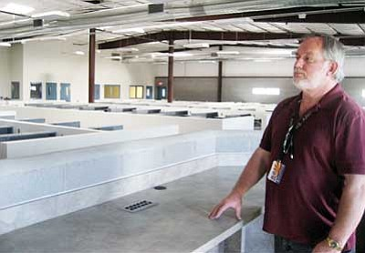 Suzanne Adams/Special to the Courier<br/>Deputy Warden of Operations Scott Yates stands at the guard station in one of the dorms in the new addition to the Arizona State Prison-Kingman. Each dorm can hold about 100 inmates.<br/>
