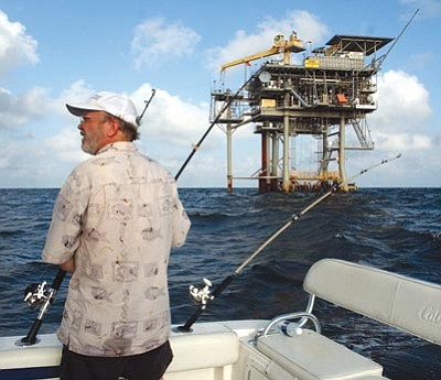 Dave Martin/The Associated Press<br/>Angler Andy Hails trolls the Gulf of Mexico near a natural gas well off the Alabama coast in this 2003 file photo. President Obama announced his new offshore drilling policy Wednesday. Obama is allowing oil drilling off Virginia's shorelines and considering it for a large chunk of the Atlantic seaboard. <br/>At the same time, he's rejecting some new drilling sites that had been planned in Alaska. <br/>