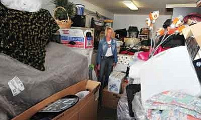 Les Stukenberg/The Daily Courier<br />Julie Strzyzewski has a garage full of boxes and furniture in Prescott Valley as she waits to close on and move into a home in <br />Chino Valley.<br /><br />