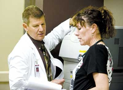 Les Stukenberg/The Daily Courier<br />Dr. Al Caccavale, who runs the hospitalist program at Yavapai Regional Medical Center, discusses a patient's progress with RN Mary McMains at the hospital's Prescott Valley campus.