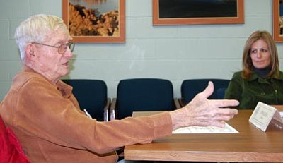 Joanna Dodder/The Daily Courier<br />John Olsen, chair of the Prescott Active Management Area's Groundwater Users Advisory Council, talks to Sandy Fabritz-Whitney, Arizona Department of Water Resources assistant director for water management, about the impacts of closing the Prescott AMA office.<br />