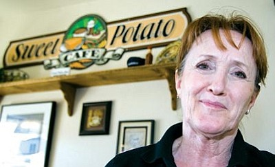 Les Stukenberg/The Daily Courier<br />Trish Bauer, former owner of Trisha's Slow Food Café, opened the Sweet Potato Café in February. <br /><br />