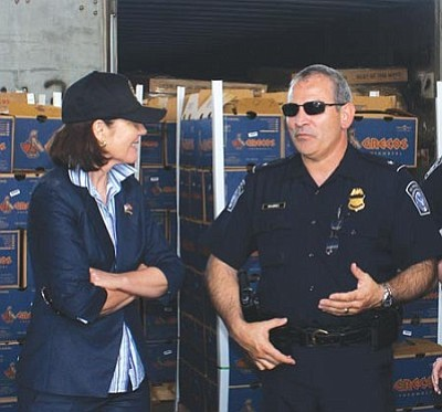 Courtesy photo<br />U.S. Rep. Ann Kirkpatrick talks Monday with Guadalupe Ramirez, Nogales Port of Entry director. <br /><br />