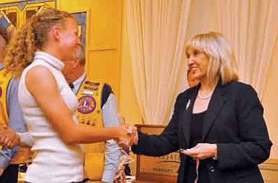 Matt Hinshaw/The Daily Courier<br /><br /><!-- 1upcrlf2 -->Gov. Jan Brewer congratulates Prescott High School student Callie Ochsner during the PHS 4.0 Honors Banquet Thursday night at the Hassyampa Inn.<br /><br /><!-- 1upcrlf2 -->