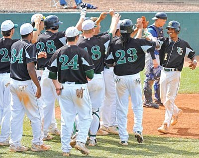 Matt Hinshaw/The Daily Courier<br /><br /><!-- 1upcrlf2 -->Yavapai College's Ty Forney, far right,  celebrates with teammates after hitting a two-run run home run versus visiting South Mountain Community College on Tuesday. YC swept the doubleheader 5-4 and 21-5.<br /><br /><!-- 1upcrlf2 -->