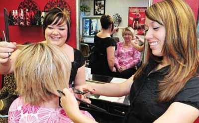 Les Stukenberg/The Daily Courier<br>Mechelle Smith and Jayme Wederski work on owner Gail Smith's hair at the new 5th Avenue Hair Studio in Prescott Tuesday morning.