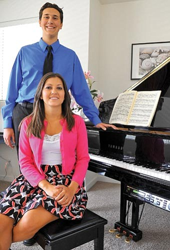 Matt Hinshaw/The Daily Courier<br> Caia Decker and James Grandjean recently won Yavapai Symphony Association scholarships totaling $5,000. The scholarships are awarded to students who plan to go into a music career.