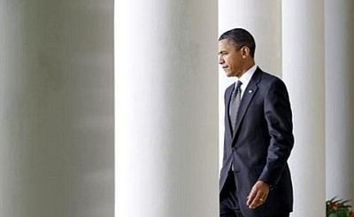 Charles Dharapak/The Associated Press<br> President Barack Obama walks through the West Wing Colonnade before he making a statement on financial reform and Wall Street in the Rose Garden of the White House in Washington Thursday.