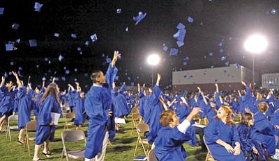 Matt Hinshaw/The Daily Courier<br> Prescott High School Class of 2010 graduates throw their mortarboards into the air Friday night after the 107th PHS Commencement ceremony.