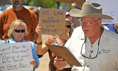 """Matt Hinshaw/The Daily Courier<br> Prescott City Councilman Steve Blair gives a statement to the media and surrounding supporters and protesters downtown about his previous comments concerning the """"Go on Green"""" mural."""