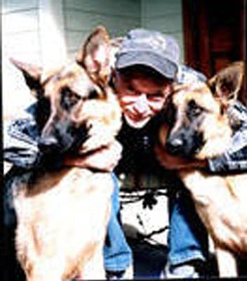 "Courtesy photo<br> Scott Jensen is pictured here with two of the six German shepherds in the Jensen family. At his request, all six dogs served as ""paw bearers"" at his funeral. Donations in Scott's memory may be mailed to the Yavapai Humane Society, 1625 Sundog Ranch Road, Prescott, AZ 86301."