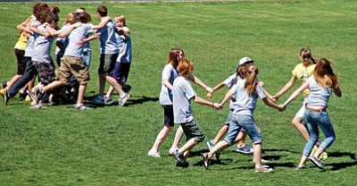 Paula Rhoden/The Daily Courier<br> Incoming freshmen participate in a team-building exercise Wednesday morning as part of Badger Week at Prescott High School.