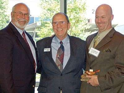 Paula Rhoden/The Daily Courier<br> Verde Valley Medical Center President Dr. James Bleicher Wednesday afternoon received the Yavapai College Foundation Presidents' Award from YC President Dr. James Horton and YCF President Howard Moody.