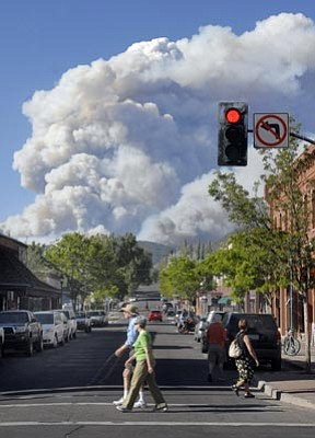 Rick Wacha/Arizona Daily Sun, AP<br>The Schultz fire, located about five miles northeast of town, billows above downtown Flagstaff on Sunday.
