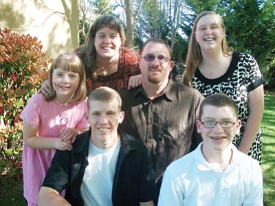 Courtesy photo<br> Rod Schuler, center, poses with his family. Schuler is leaving his teaching job at Prescott High School to become the Family Ministries Director at Harvest  Bible Chapel.