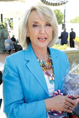 Ross D. Franklin/The Associated Press<br> Gov. Jan Brewer attends a ceremony commemorating the 60th anniversary of the start of the Korean War Friday in Phoenix.