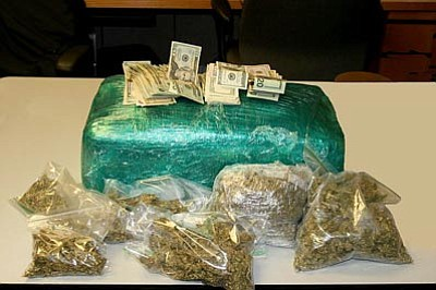 Prescott Police Department/Courtesy<br>Police seized more than 23 pounds of marijuana, a digital scale, and baggies of marijuana as well as $3,186 in cash from Migel Rosalio Montez' Prescott home.
