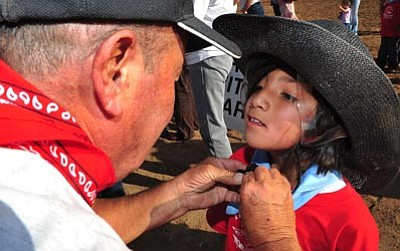 Les Stukenberg/The Daily Courier<br>Alicia McMurray gets her helmet fastened on during the annual Happy Hearts Rodeo before the first performance of the Prescott Frontier Days Rodeo Monday night.
