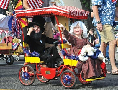 Brett Soldwedel/The Daily Courier<br> Ethan Brinkerhoff, 5, and sister Ella are dressed up as Abraham Lincoln and Betsy Ross during the Kiwanis Kiddie Parade in downtown Prescott Friday.