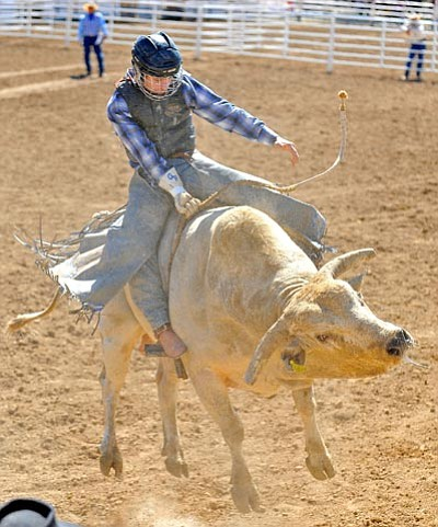 Matt Hinshaw/The Daily Courier<br /><br /><!-- 1upcrlf2 -->Gunar Ramsey hold on as a bull jumps  during the Saturday afternoon performance of the Prescott Frontier Days World's Oldest Rodeo.