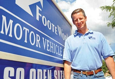 Brett Soldwedel/The Daily Courier<br>Ken Foote is the owner of FooteWork, which has three locations that process auto licenses and titles.