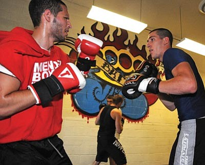 Photos by Brett Soldwedel/The Daily Courier<br /><br /><!-- 1upcrlf2 -->Northern Arizona MMA gym trainer Danny Hilton, right, spars with Adel Al-A'ali in Prescott Valley on Monday.