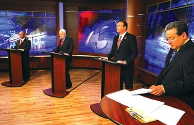 Ross D. Franklin/The Associated Press<br> Sen. John McCain, second from left, former congressman J.D. Hayworth, second from right, political newcomer Jim Deakin, left, and Channel 3 moderator Frank Camacho attend the first Arizona Senate Republican debate at KTVK Channel 3 Friday in Phoenix.