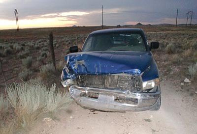 Prescott Valley Police/Courtesy<br>The blue pickup truck that fled the scene of a hit-and-run collision Sunday evening is seen parked at State Route 89A and Viewpoint Drive.
