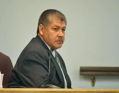 Les Stukenberg/The Daily Courier<br> Sgt. Luis Huante of the Yavapai County Sheriff's Office listens to a question during cross-examination by defense attorney John Sears on Thursday at the trial of Steven DeMocker, who is accused of murdering his ex-wife, Carol Kennedy.