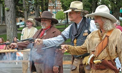 """The Daily Courier/File <br> The Prescott Regulators fire away at a previous """"Shootout on Whiskey Row"""" event, benefiting Yavapai Big Brothers Big Sisters."""