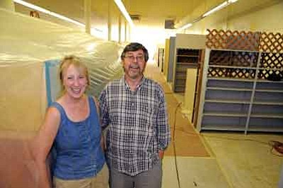 Brett Soldwedel/The Daily Courier<br>Laura and Fred Hughes are ecstatic about the renovation of their retail space in downtown Prescott on Wednesday. They are developing about 65 individual spaces to lease, creating an emporium with artists, jewelers, antiquers and other vendors.