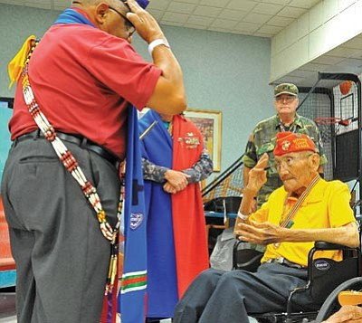 Matt Hinshaw/The Daily Courier<br> Sgt. Alfonso Santillan Jr., USMC (ret.), Commander, Military Order of the Purple Heart, salutes Navajo code talker Sgt. Allen D. June, USMC Ret., after June was awarded the Warriors Medal of Valor Thursday afternoon at the Bob Stump VA Medical Center in Prescott. June is one of the original 29 Navajo Code Talkers.