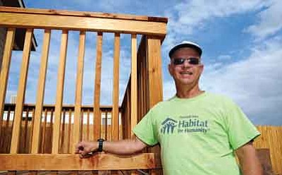 Brett Soldwedel/The Daily Courier<br>Marty Grossman, volunteer with Habitat for Humanity, helped construct this house in Chino Valley. The volunteers were putting final touches on landscaping this past Thursday.