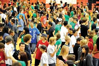Les Stukenberg/The Daily Courier<br>Students arrange themselves by birthday as Bradshaw Mountain High School introduced freshman to high school through the use of Links Crews, in which juniors and seniors are trained to serve as role models for the freshman.  On Friday, the freshman attended a regular day of school for orientation and to meet their upperclassmen Link leaders. Students also had a chance to meet faculty, receive class schedules and have a BBQ.