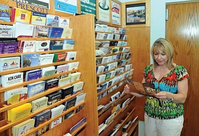 Brett Soldwedel/The Daily Courier<br>Maria Arieno of Buffalo, N.Y., stops in the Prescott Valley Visitor Center on Thursday.