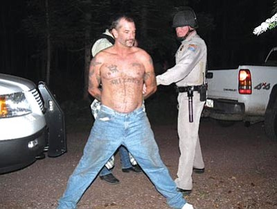 U.S. Marshals Office/The Associated Press<br> Fugitive John McCluskey is taken into custody Thursday by U.S. Marshals in eastern Arizona.