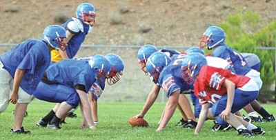 Brett Soldwedel/The Daily Courier<br /><br /><!-- 1upcrlf2 -->Mayer's offensive and defensive units scrimmage during practice on Wednesday. The Wildcats open their season at home Friday versus area rival, The Orme School. Kickpoff is 7 p.m.