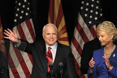 Ross D. Franklin/The Associated Press<br> Sen. John McCain, R-Ariz., left, waves to supporters at an election victory party with his wife Cindy McCain Tuesday in Phoenix.