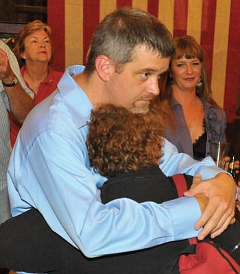 Matt Hinshaw/The Daily Courier<br> Bradley Beauchamp embraces Fran Schumacher after the first round of results showed him trailing behind Dr. Paul Gosar Tuesday night at the Palace Saloon in Prescott.