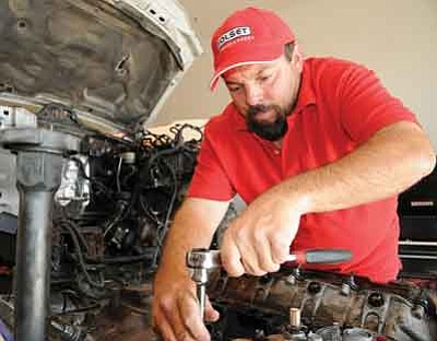 Brett Soldwedel/The Daily Courier<br>John Hughes, owner of H & H Diesel Performance in Dewey, said he likes to get his hands dirty when he works on engines.