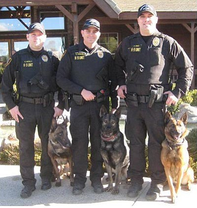 Prescott Valley Police Department/Courtesy photo<br> Officer McNally with Ike, Officer O'Hagan with Bojar and Officer Hines with Joey of the Prescott Valley Police Department had a busy weekend last week.