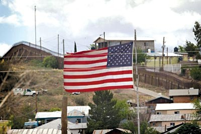 Matt York/The Associated Press<br> In this April 22 photo, the American Flag flies along the international border in Nogales, Ariz.  The first of 532 National Guard troops are set to begin their mission in the southern Arizona desert on Monday under President Barack Obama's plan to beef up U.S.-Mexico border security, although they won't have any law enforcement authority.